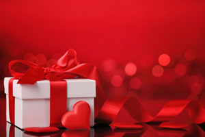 Valantines Present. White Box with red hearts and ribbon