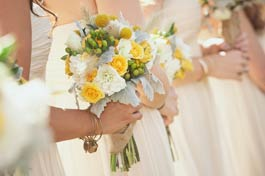 Bridesmaids in a line with posies