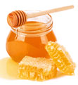 Pot of honey with honey comb