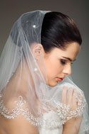 Bride withnet and lace veil