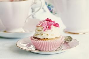 Pink Velvet Cupcake with Spoon on Plate