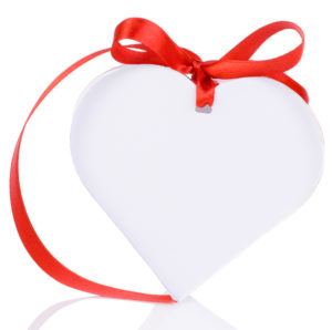 White heart box tied with red ribbon