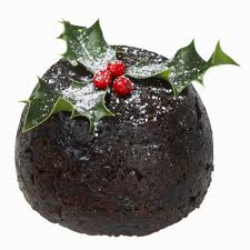 Traditional English Christmas pudding with Holly Leaves